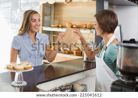 Barista serving a happy customer at the coffee shop - stock photo