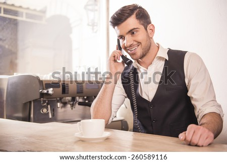 Baristas is taking orders over the phone. - stock photo