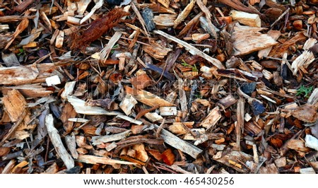 Bark leaves and wood chippings mulch as an abstract coarse background texture