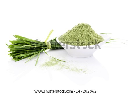 Barley Grass and Wheatgrass. Blades and powder isolated on white background. Green foods. Natural organic healthy living. - stock photo