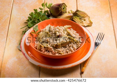 barley risotto with  artichoke - stock photo