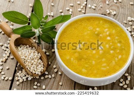 Barley soup, close-up - stock photo