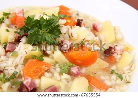 Barley soup on  a wooden background