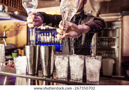 Barman at work, preparing cocktails. concept about service and beverages - stock photo