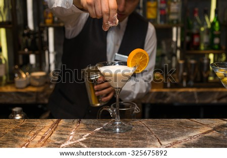 Barman at work, preparing cocktails. preparing pina colada cocktail. concept about service and beverages. - stock photo