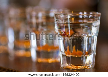 Barman make alcoholic shots in nightclub