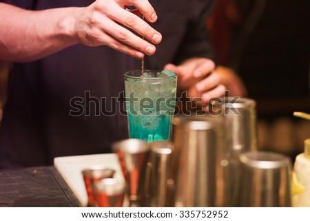 Barman stir alcohol. process of preparing a cocktail - stock photo