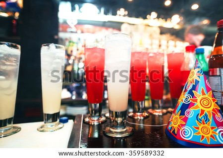 Barman stir alcohol. Process of preparing a cocktail. Alcoholic beverages in glass - stock photo
