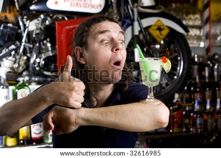 barman to do a cocktail Margaritas with lime on an elbow and surprise - stock photo