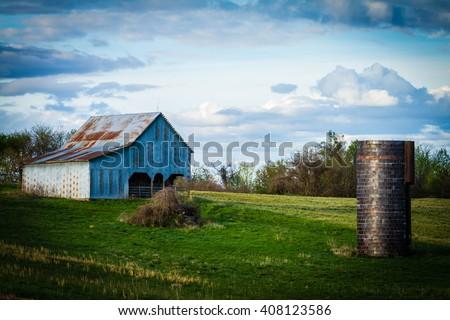 Barn and Brick Silo - stock photo