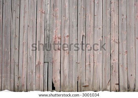 barn boards siding in winter with snow