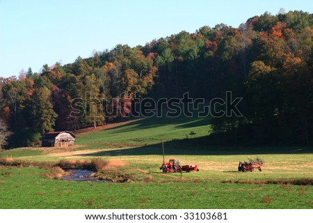 Barn in field with a touch of fall near Ellijay Georgia. - stock photo