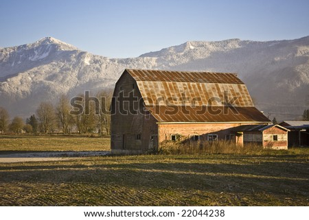Barn on winter field - stock photo
