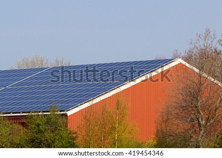 barn roof with solar panels - stock photo