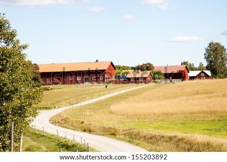 Barn under cloudy sky in Sweden.. - stock photo