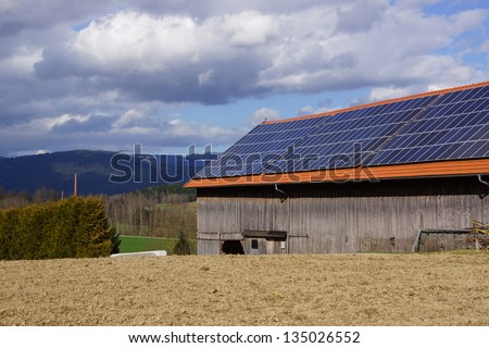Barn with photovoltaic cells on the roof - stock photo