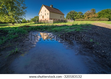 Barn with Reflection in puddle