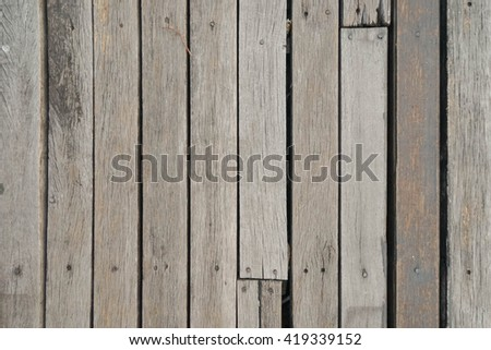 Barn wood background with knots and nail holes - stock photo