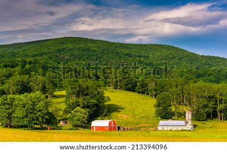 Barns and a mountain in the rural Potomac Highlands of West Virginia. - stock photo