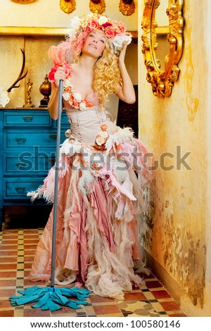 baroque fashion blonde housewife woman at mop cleaner chores - stock photo