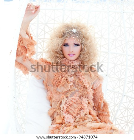 Baroque haute couture woman portrait with vampire inspiration in hammock - stock photo