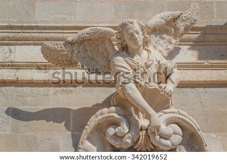 Baroque statue of angel decorating the facade of church in Dubrovnik, Croatia