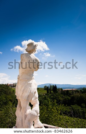 Baroque statue on a background of hills and vineyards - stock photo