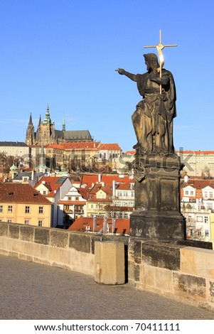 Baroque Statues on the Prague Charles Bridge with beautiful Castle - stock photo