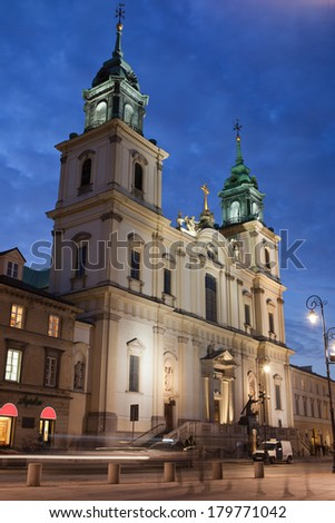 Baroque style Church of the Holy Cross at night in Warsaw, Poland.