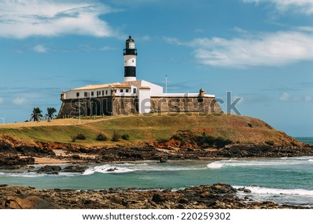 Barra Lighthouse (Farol da Barra) in Salvador, Brazil. It was built in 1698 and was the first lighthouse in the Americas. Its lamp was fueled by whale oil. The lighthouse was electrified in 1937.