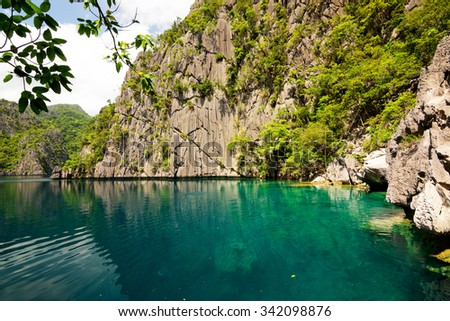 Barracuda lake on Coron Island, surrounded by limestone cliffs, is a popular tourist attraction and diving spot at the Philippines         - stock photo