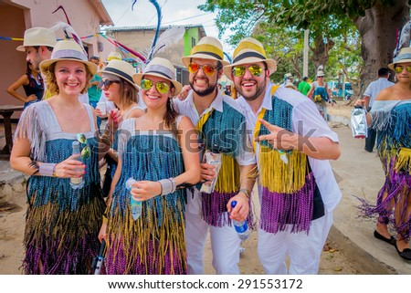 BARRANQUILLA, COLOMBIA - FEBRUARY 18, 2015: Caucasian and Colombian performers with colorful and straw hats participate in Colombia's most important folklore celebration, the Carnival of Barranquilla - stock photo