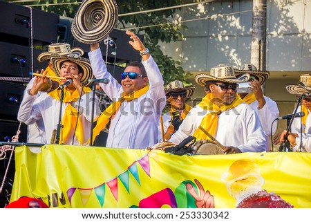 BARRANQUILLA, COLOMBIA - FEBRUARY 15, 2015: Performers with colorful and elaborate costumes participate in the Great Parade of Carnaval singers of vallenato - stock photo
