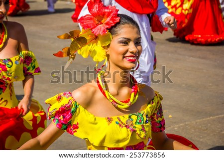 BARRANQUILLA, COLOMBIA - FEBRUARY 15, 2015: Performers with colorful and elaborate costumes participate in the Great Parade of Carnaval Smiling woman - stock photo