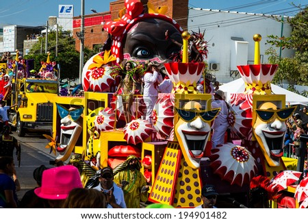 Barranquilla, Colombia - March 1, 2014 - Colorful floats full of singers, dancers make their way down the street during the Battalla de Flores. The pinnacle parade of the Carnaval de Barranquilla. - stock photo