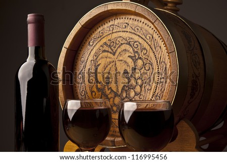 barrel, bottles and glasses of wine and ripe grapes - stock photo