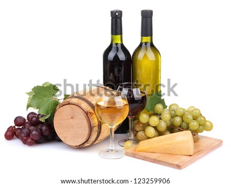 Barrel, bottles and glasses of wine, cheese and grapes, isolated on white - stock photo