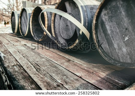 Barrel Casks Outdoor Winter. Old barrel casks outdoors during winter. Slight vintage filter added. - stock photo