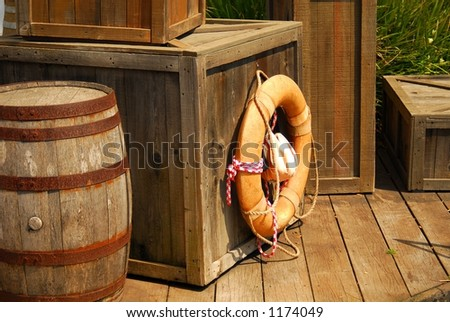 Barrel, crate, & life-preserver - stock photo