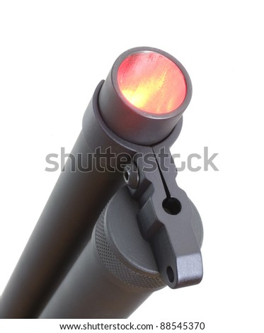 Barrel of a shotgun glowing from within in red and yellow