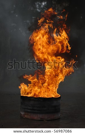 Barrel of oil on fire, this is very hot - stock photo