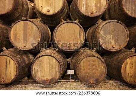 Barrels in the wine cellar, Porto, Portugal - stock photo