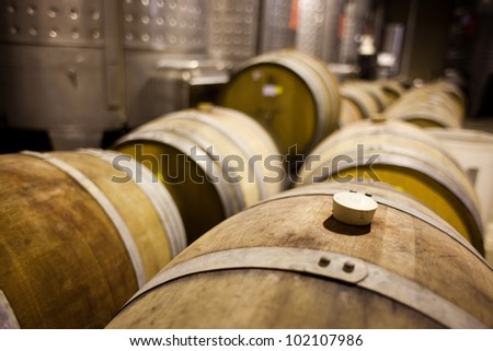 Barrels of South African wine in a wine cellar - stock photo
