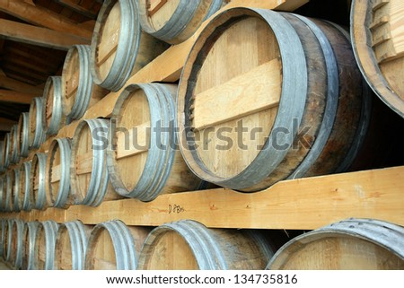 Barrels stored in a cellar - stock photo