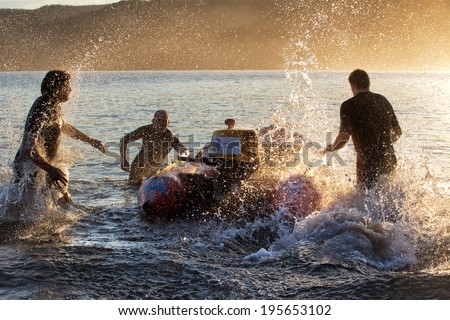 BARRENJOEY,AUSTRALIA - MAY 25,2014: Surf lifesavers practice their boat drills in Pittwater Estuary. Surf Live Saving Australia has 300+ clubs with nearly 170,000 members, most of whom are volunteers.