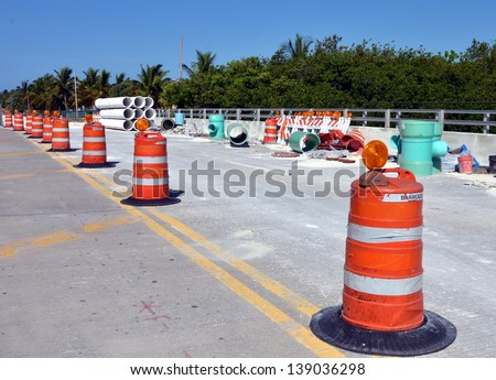 Barricades And Large Sewer Pipes On A Road Construction Site