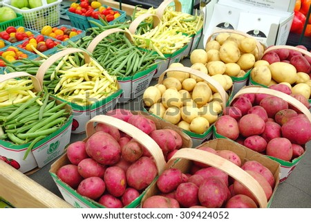 BARRIE, CANADA - AUGUST 8, 2015: Tomatoes selection at a farmers market in Barrie, Canada.   - stock photo
