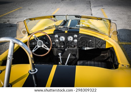 Barrie, Ontario, July 11, 2015 gorgeous beautiful amazing stunning  closeup view of classic retro vintage race car open cab and dashboard  - stock photo