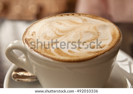 Barrista cappuccino latte art - foamy coffee with pattern on top