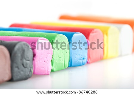 Bars of colorful modeling clay used for children to play. Shallow DOF - stock photo